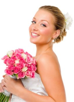 Pretty bride with flowers - why not create your own homemade bridal bouquets ?