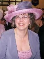Mother at her son's wedding, with lilac hat