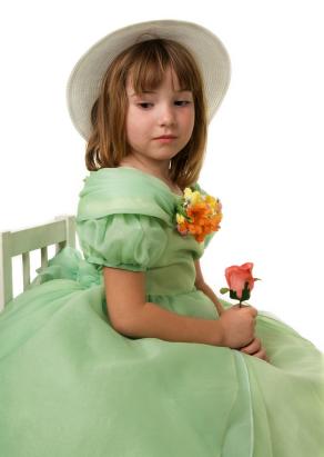 Elegant girl wearing Easter dress & bonnet
