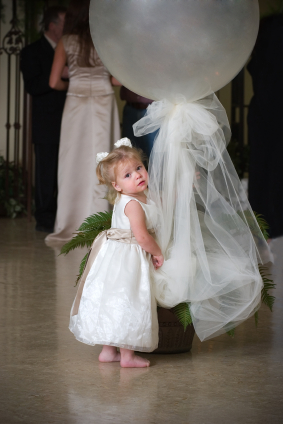 Young girl wears pretty party or flower girl gown